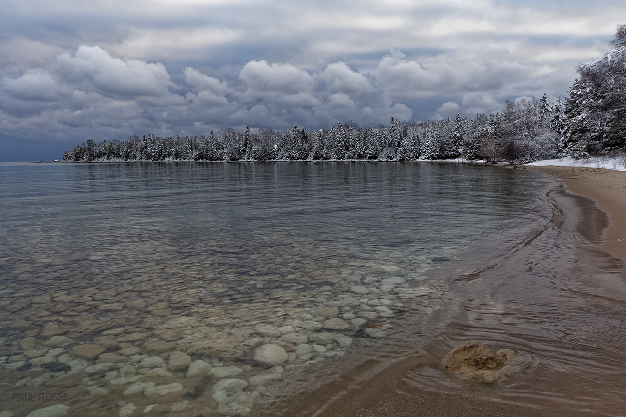 This image has an empty alt attribute; its file name is lake-huron-shoreline-first-snow.jpg